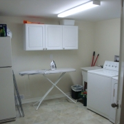 Laundry room in basement of Toronto House
